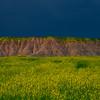 A Dark Wall Of Clouds Behind - Badlands National Park, South Dakota