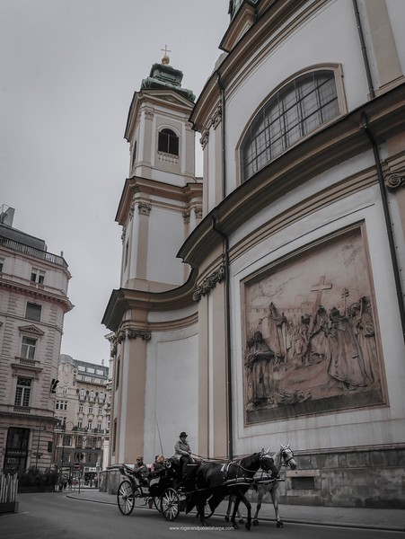 Horse and carriage outside the St. Peter's Catholic Church. Vienna Austria