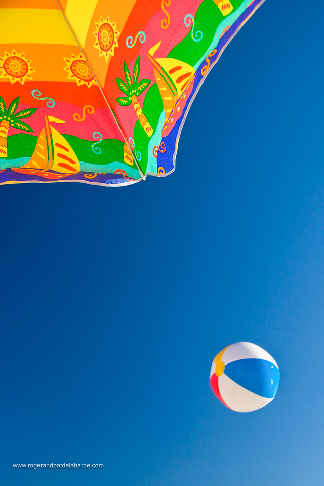 Beach ball and brolly. Cape Town. Western Province. South Africa