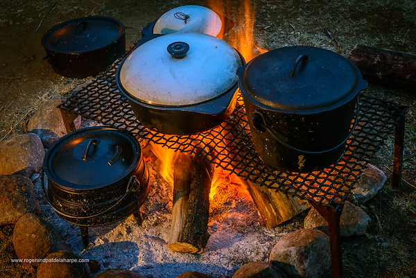 Three legged cooking pots (potjie) around a fire. KwaZulu Natal. South Africa