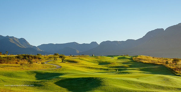 9th hole at Kingswood Golf Estate with Outeniqua mountains in the background. George. Garden Route, Western Cape. South Africa