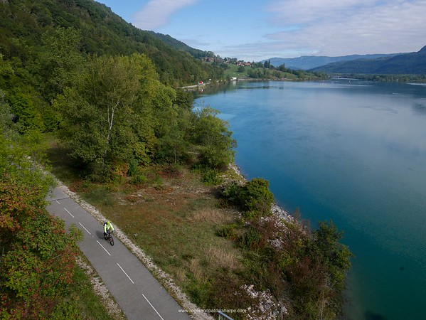 The Rhône River near Belley and Roger on an ebike cycling the Rhone Cycle Route