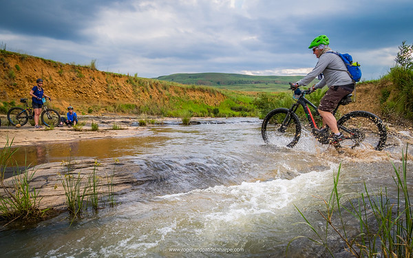 Howard crossing a river on one of the All Out Adventures Mountain Biking trails. Northern Drakensberg. KwaZulu Natal. South Africa