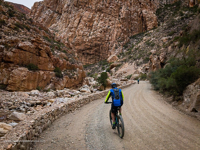 Mountain biking on Swartberg Pass. Prince (Prins) Albert. Western Cape. South Africa