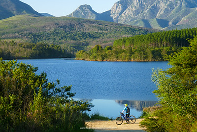 Image No: TZ110R361988 Roger with the glorious scenery at Garden Route Dam. eBiking (mountain biking). Western Cape. South Africa