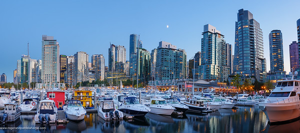 Evening views of city skyline from harbour. Vancouver. British Columbia. Canada.