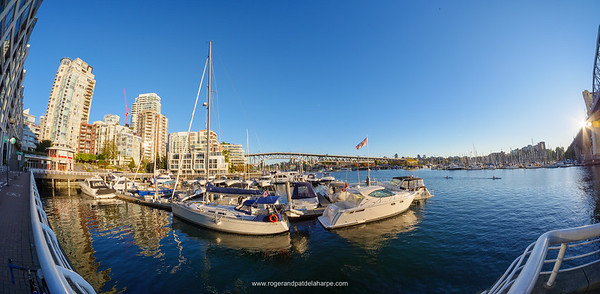 View of boats and marinas in False Creek with Granville Bridge in the background. Vancouver. British Columbia. Canada.