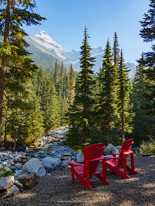 Red chairs at Glacier National Park near Golden. British Columbia. Canada.