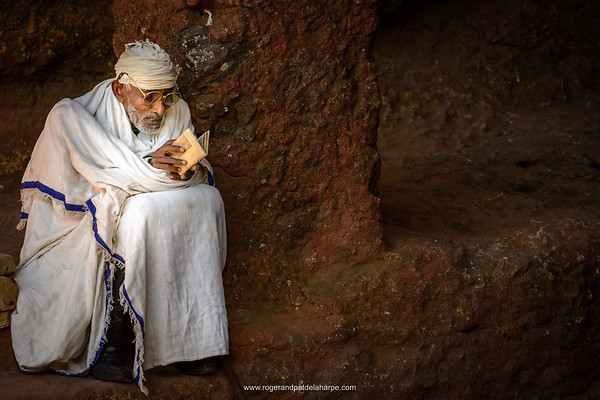 Pilgrim reading a bible. Lalibela. Ethiopia.