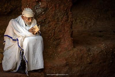 Pilgrim reading a bible. Lalibela. Ethiopia.