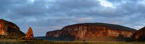 View of Fischer's Tower, a volcanic plug and Columnar basalt cliffs. Hells Gate National Park. Naivasha. Great Rift Valley. Kenya