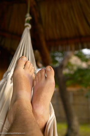 Lying in a hammock at Vilanculos Beach Lodge. Vilanculos. Mozambique