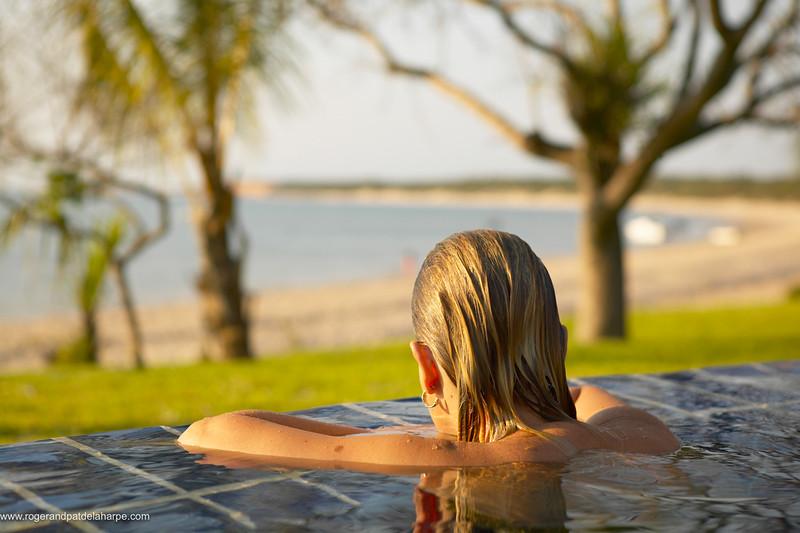Woman in swimming pool. Indigo Bay Lodge. Bazaruto. Mozambique