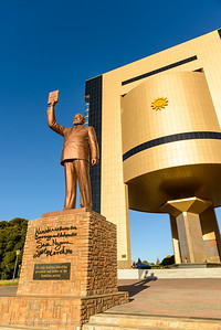 The Independence Memorial Museum and a statue of former President Sam Nujoma facing Windhoek with him holding the 'Constituency Book'. Windhoek. Namibia