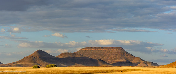 Desert scenery and Etendeka Mountains. Desert Rhino Camp. Palmwag Concession. Namibia.