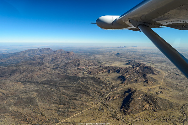 Aerial view of Namibia showing the Erongo Plateau below and The Spitzkoppe in the distance.