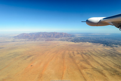 Aerial view of Namibia with the Brandberg on the horizon.