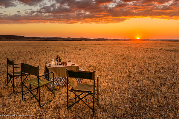Sundowners and desert scenery. Desert Rhino Camp. Palmwag Concession. Namibia.