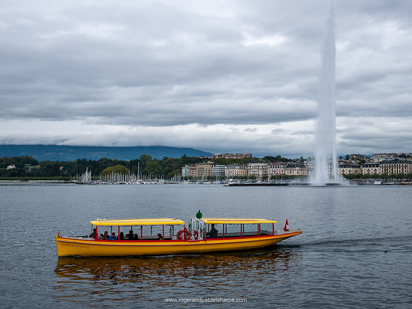 The Jet D'Eau and a water taxi on Lake Geneva, Geneva, Switzerland