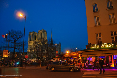 Street scene in the Latin Quarter with the Notre Dame Cathedral in the background. Paris. France