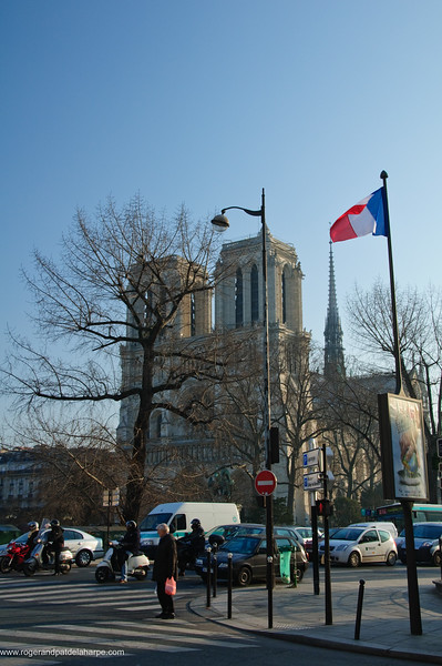 Street scene in the Latin Quarter with Notre Dame Cathedral in t he background. . Paris. France