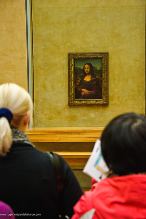 Tourists looking at the Mona Lisa in the Louvre Art Gallery or Musée du Louvre. Paris. France