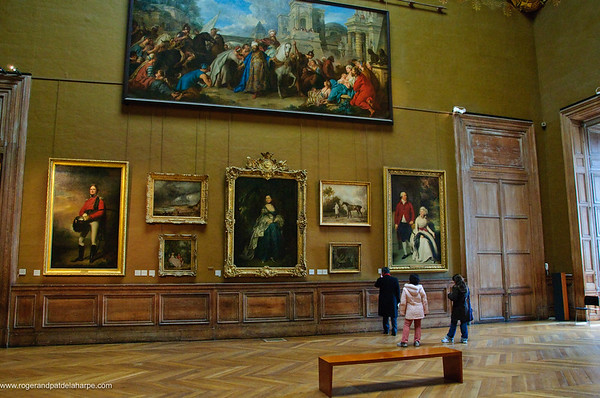 Tourists looking at art in the Louvre Art Gallery. Paris. France