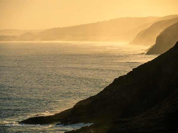 Image Number GH5R315698. Sunset view west along the sea cliffs near Herolds Bay. Graden Route. Western Cape. South Africa
