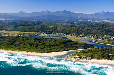 Sedgefield and Sedgefield Lagoon with Oteniqua Mountains in distance. Aerial view. Sedgefield. Garden Route. Western Cape, South Africa.