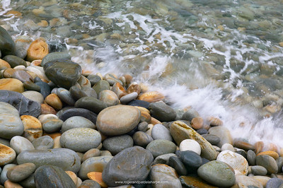 Waves breaking onto pebbles. Storms River National Park. Western Cape. South Africa
