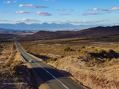 Route 62 near Ladismith with the Swartberg Mountains in the Background. Western Cape. South Africa