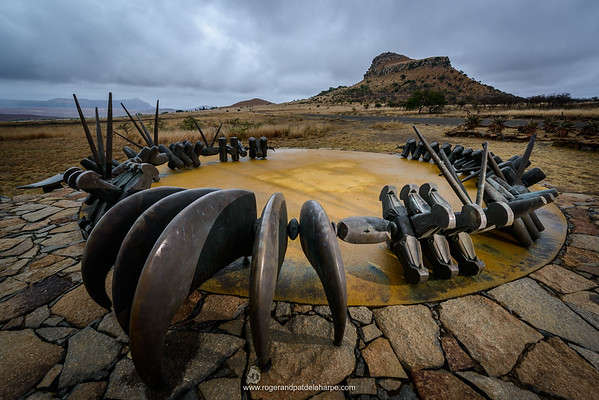 The Monument to the fallen Zulu Warriors at Isandlwana Battlefield. KwaZulu Natal Midlands. South Africa. The monument is in the form of a large bronze iziqu (bravery) necklace, symbolising courage and loyalty to the Zulu kings.