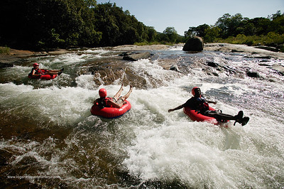 Tourists doing white water tubing in Sabi River. Hazyview. Mpumalanga. South Africa