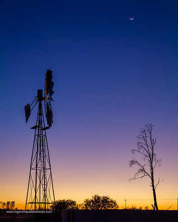 Image Number G9R390400. A windmill (windpump) against a beautiful dawn sky at the tiny Karoo town of Freserburg. Northern Cape. South Africa.