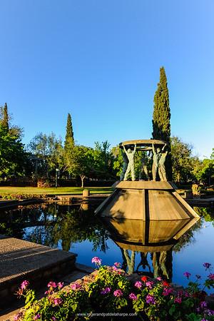 Memorial to Sir Ernest Oppenheimer, mining magnate and erstwhile mayor of Kimberley. Surrounded by a rose garden, the Miners Memorial or Diggers Fountain, comprising a fountain and statue of five miners holding up a sieve, was erected to honour diamond diggers, past and present.Kimberley. Northern Cape. South Africa.