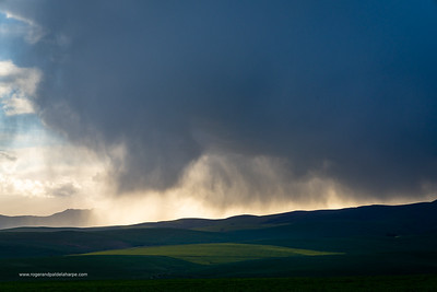 Image Number a7Riv403034. Storm clouds over farmlands. Near Caldon. Overberg. Western Cape. South Africa
