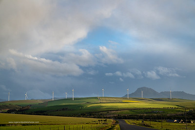 Image Number a7Riv403050. Storm clouds over farmlands and the Wind turbines on the 27 MW Klipheuwel Wind Farm. Near Caldon. Overberg. Western Cape. South Africa