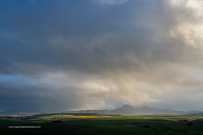 Image Number a7Riv403039. Storm clouds over farmlands and the Wind turbines on the 27 MW Klipheuwel Wind Farm. Near Caldon. Overberg. Western Cape. South Africa