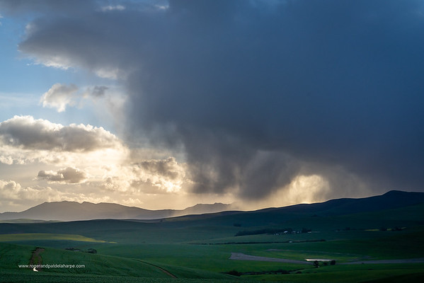Image Number a7Riv403014. Storm clouds over farmlands. Near Caldon. Overberg. Western Cape. South Africa