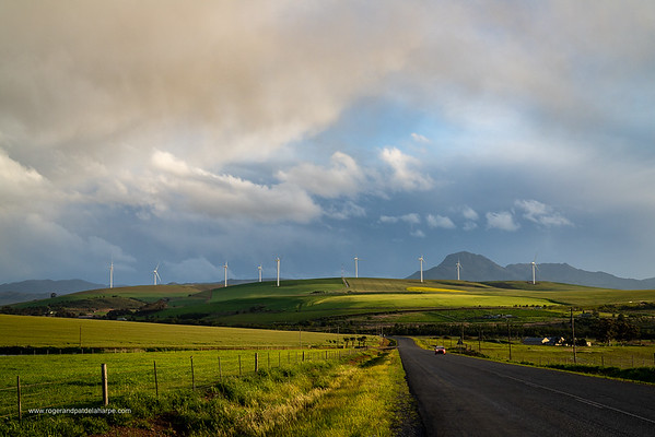 Image Number a7Riv403041. Storm clouds over farmlands and the Wind turbines on the 27 MW Klipheuwel Wind Farm. Near Caldon. Overberg. Western Cape. South Africa