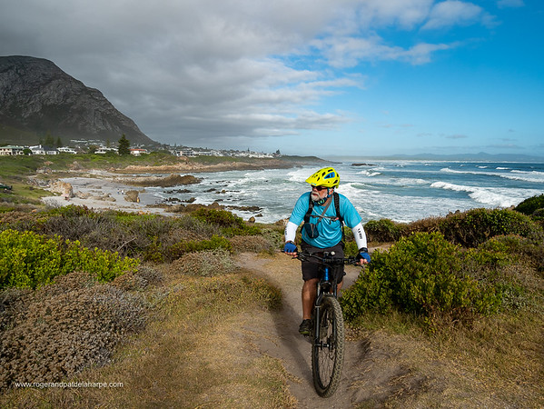 Image Number GM5R385282. Roger de la Harpe, ebiking at Skulpiesbaai with views across Walker Bay. Hermanus. Whale Coast. Overberg. Western Cape. South Africa