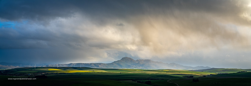 Image Number a7Riv403020-Pano. Storm clouds over farmlands and the Wind turbines on the 27 MW Klipheuwel Wind Farm. Near Caldon. Overberg. Western Cape. South Africa