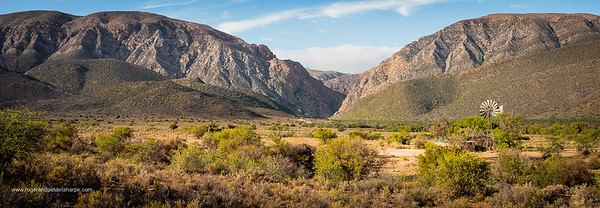 Windmill and Swartberg Mountains showing start of the Swartberg Pass. Prince (Prins) Albert. Western Cape. South Africa