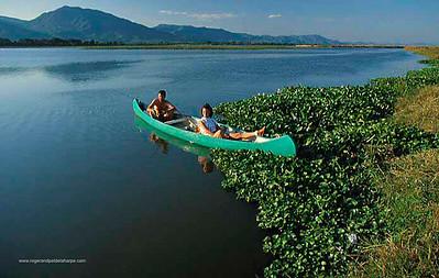 Fishing from canoe on Zambezi River. Mana Poola National Park. Zimbabwe