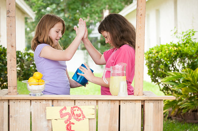 Two young girls high fiving
