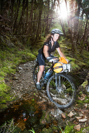 Female bikepacker on Big River track, Reefton.