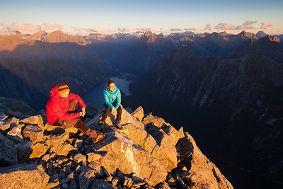 Two climbers on summit of Mitre Peak at sunset, Fiordland National Park