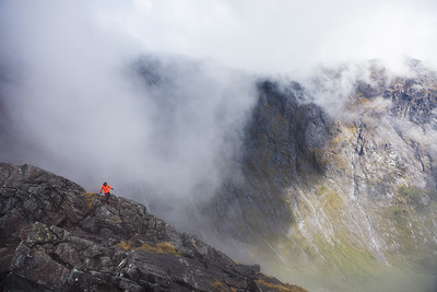 A climber walks alone on Homer Saddle above the Cleddau Valley, Fiordland National Park