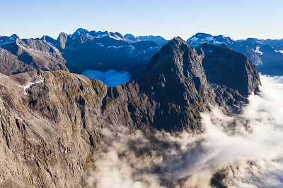 Apirana Peak above Donne Valley. Sabre Peak and Moraine creek behind, Darran Mountains, Fiordland National Park