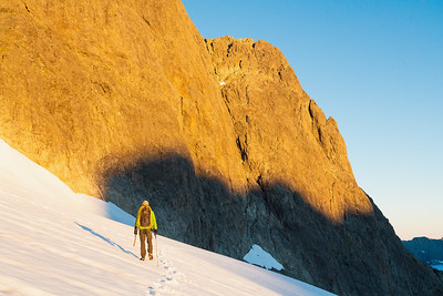 Mountaineer approaches the North East Face of Mt Patuki, Cleft Creek, Darran Mountains, Fiordland National Park, New Zealand